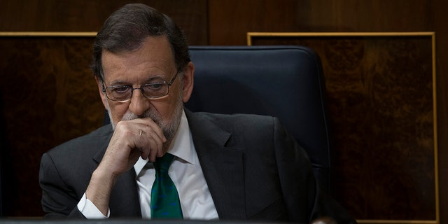 Spain's Prime Minister and Popular Party leader Mariano Rajoy listens to speeches during the first day of a motion of no confidence session at the Spanish parliament in Madrid.