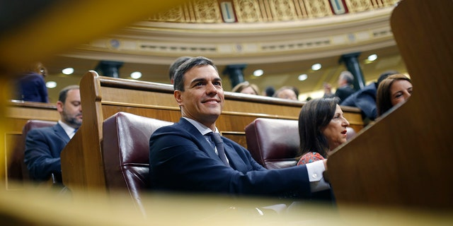Spain's socialist opposition leader Pedro Sanchez sits at the start of the second day of a motion of no confidence session at the Spanish parliament in Madrid.