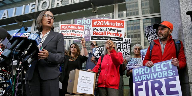 In this June 10, 2016 file photo, Stanford law professor Michele Dauber speaks at a rally before activists delivered over one million signatures to the California Commission on Judicial Performance calling for the removal of Judge Aaron Persky from the bench in San Francisco.