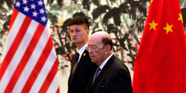 U.S. Commerce Secretary Ross, foreground, is in Beijing for trade talks after Washington ratcheted up tensions with a new threat of tariff hikes on Chinese high-tech exports.