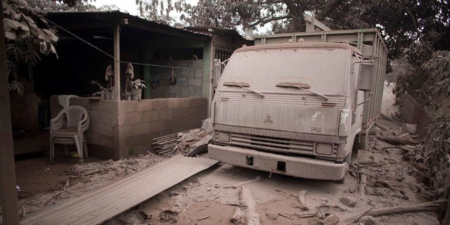A truck is covered in volcanic ash spewed by Volcan de Fuego, or Volcano of Fire, in Escuintla, Guatemala, Monday.