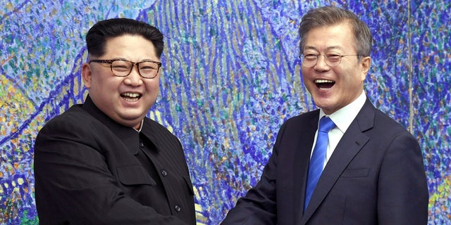 """South Korean President Moon Jae-in, right, met with North Korean leader Kim Jong Un ahead of Kim's summit with President Trump. Moon reportedly told Trump that South Koreans are praying for a """"miraculous result"""" from the Singapore summit."""