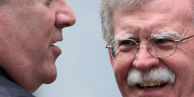 National Security Adviser John Bolton, right, is in Singapore with the U.S. delegation.