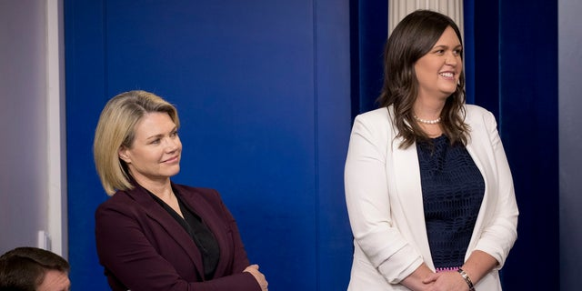 White House press secretary Sarah Sanders, right, is in Singapore with the U.S. delegation.