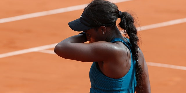 Sloane Stephens of the U.S. reacts after missing a ball against Romania's Simona Halep in the final match of the French Open tennis tournament at the Roland Garros stadium .