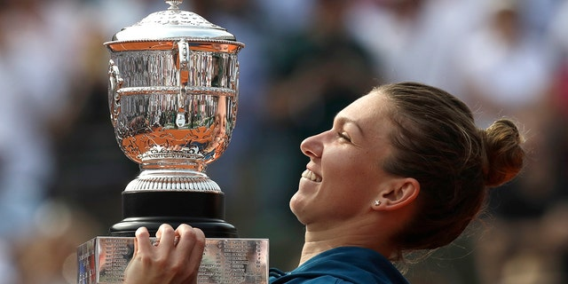 Romania's Simona Halep holds the cup after defeating Sloane Stephens of the U.S. during their final match of the French Open tennis tournament at the Roland Garros stadium.