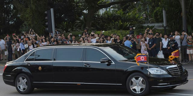 Kim Jong Un in a pullet-proof limousine in Singapore.