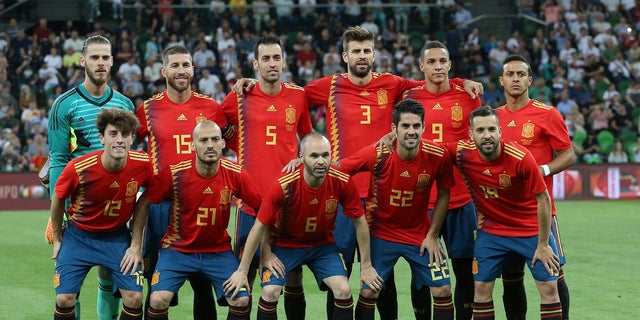 Spain's jersey forgoes symmetry for a row of yellow and purple triangles down the side of the red kit.