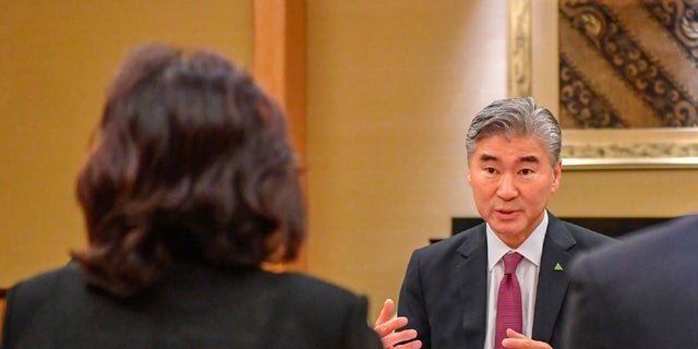 U.S. Ambassador Sung Kim talks with members of the North Korean delegation during a working group meeting in Singapore ahead of President Trump's meeting with North Korean leader Kim Jong Un.