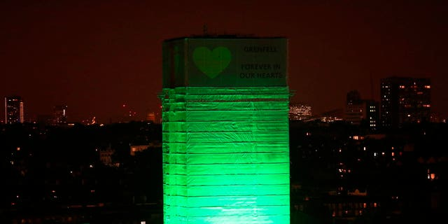 Grenfell Tower in London is illuminated in green on Thursday to mark a year since the moment the devastating fire took hold, claiming 72 lives