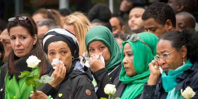 Families of victims of the Grenfell Tower disaster attend a service of remembrance in west London