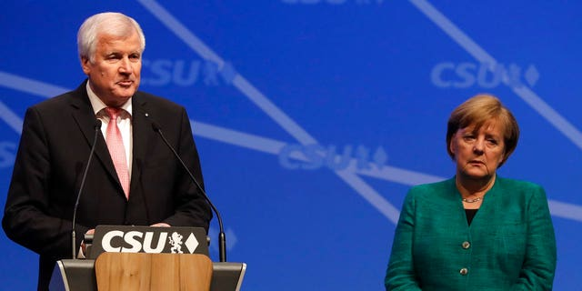 Difference of opinion: Horst Seehofer (left) wants Germany to turn back refugees who have already registered in other countries, a sharp contrast to Merkel's open door policy