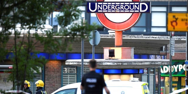 Emergency services personnel are seen near the Southgate Underground station in London in an undated photo (Associated Press).