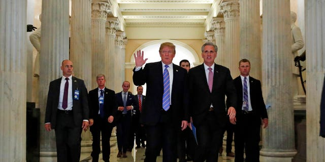President Donald Trump and House Majority Leader Kevin McCarthy of California are seen at the U.S. Capitol, in Washington, June 19, 2018.