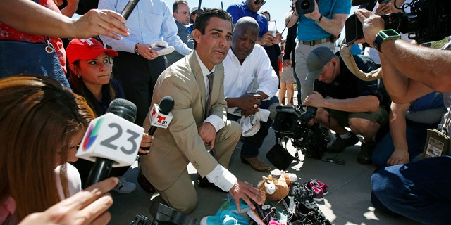 Miami Mayor Francis Suarez, left, and Columbia, South Carolina Mayor Steve Benjamin explain to the media the symbolic gesture of bringing shoes as gifts for immigrant children that are being held at a facility in Tornillo, Texas, near the Mexican border, Thursday, June 21, 2018.
