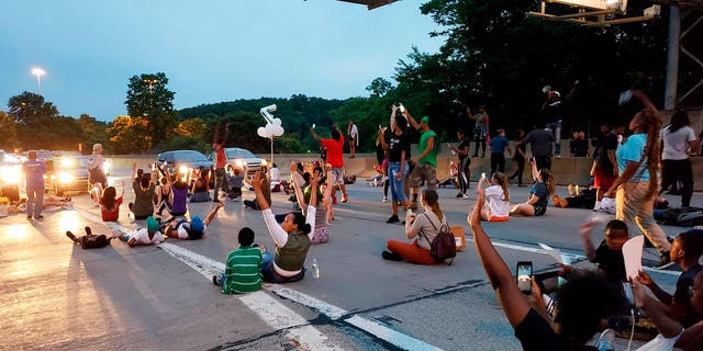 People protesting the East Pittsburgh police after the June 19 shooting death of Antwon Rose shut down Interstate 376 in Pittsburgh on Thursday