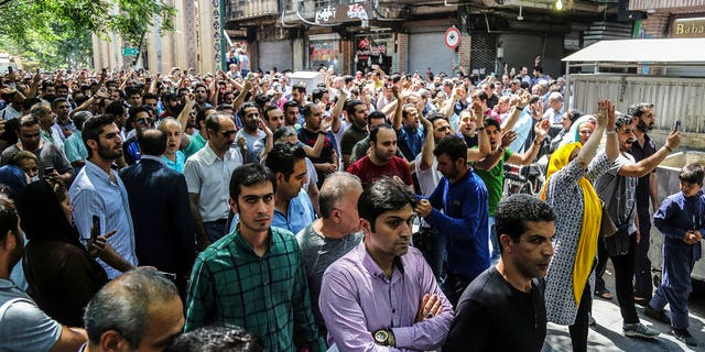 Iran has been beset by economic protests in recent days; a group of protesters chant slogans at the old grand bazaar in Tehran on Monday
