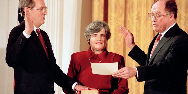 In this Feb. 18, 1988, photo Anthony Kennedy, left, takes the constitutional oath as a Supreme Court Associate Justice from Chief Justice William Rehnquist at a White House ceremony.