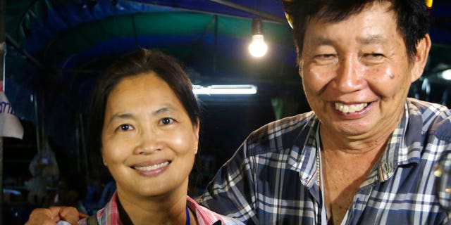 Family members smile after hearing the news that the missing 12 boys and their soccer coach have been found, in Mae Sai, Chiang Rai province