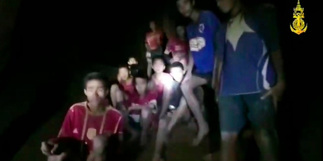 In this grab taken from video provided by the Thai Navy Seal, a view of the boys and their soccer coach as they are found in a cave in northern Thailand more than a week after they went missing.