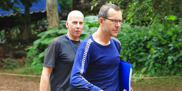 Richard Stanton, left, and John Volanthen arrive in Mae Sai, Chiang Rai province, in northern Thailand; the divers helped locate the boys 10 days after they went missing in the caves