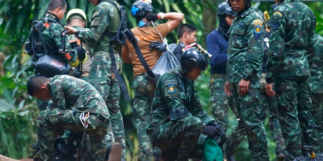 Thai rescuers prepare to enter the cave where 12 boys and their soccer coach have been trapped since June 23