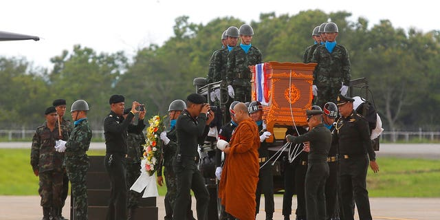 The body of Saman Gunan, a former Thai navy SEAL who died during an overnight mission, is carried during a repatriation and religious rites ceremony at Chiang Rai Airport in Mae Sai