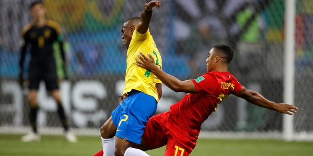 Brazil's Douglas Costa, left, is tackled by Belgium's Youri Tielemans during the quarterfinal match between Brazil and Belgium. Belgium won the match 2-1.