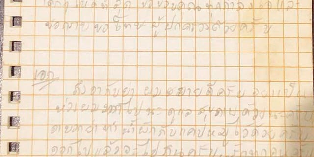 An undated photo shows handwritten notes by one of the children and their coach trapped in a cave in Mae Sai, Thailand.