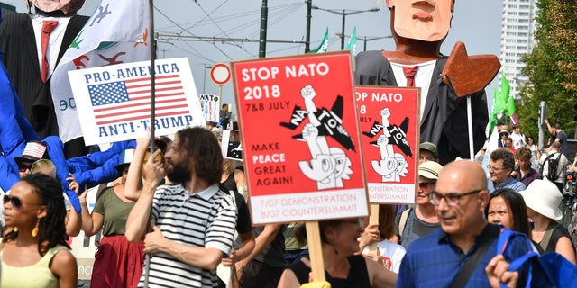 European activists are protesting President Trump's upcoming appearance at a NATO summit, marching through Brussels to plead for less military spending and more public money for schools and clean energy.