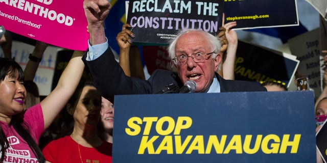 Sen. Bernie Sanders, I-Vt., speaks with protesters in front of the Supreme Court after President Trump announced Judge Brett Kavanaugh as his Supreme Court nominee.