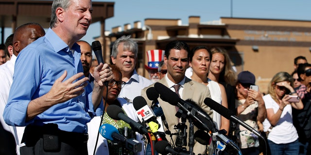 New York Mayor Bill de Blasio speaks alongside a group of other U.S. mayors during a news conference outside a holding facility for immigrant children in Tornillo, Texas.