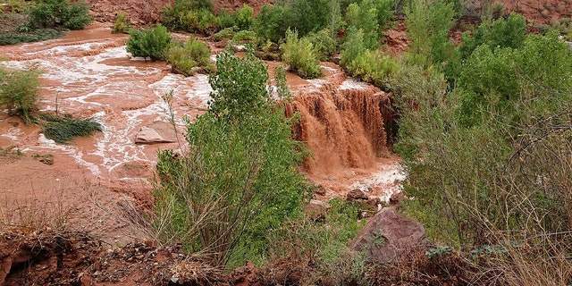 Flooding from a waterfall on the Havasupai reservation in Supai, Ariz., forced about 200 tourists to evacuated from a campground on tribal land near famous waterfalls deep in a gorge off the Grand Canyon, Thursday, July 12, 2018.