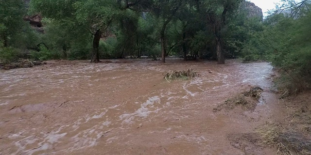 Torrents of water wash over a campground in Supai, Ariz., July 11, 2018.