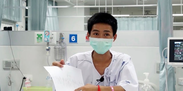Adul Sam-on, one of the 12 boys rescued from the flooded cave, in their hospital room at Chiang Rai Prachanukroh Hospital in Chiang Rai province, northern Thailand.