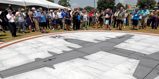 Following the service, the crowd was driven in buses to witness the unveiling of the nearby memorial, which displays an image of a KC-130T plane set in granite and surrounded in a circle by the engraved names of the fallen.
