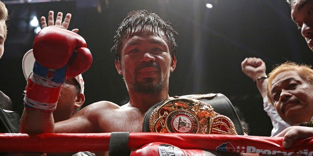 Manny Pacquiao of the Philippines poses after defeating Lucas Matthysse of Argentina during their WBA World welterweight title bout in Kuala Lumpur, Malaysia, Sunday, July 15, 2018.
