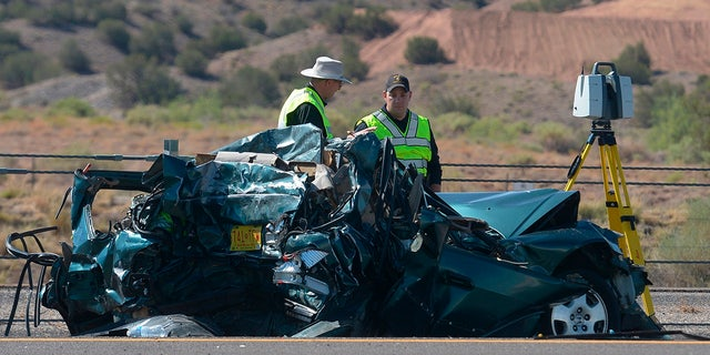 Emergency personnel work at the scene of a deadly multi-vehicle crash involving a bus that occurred on Interstate 25 just north of Bernalillo, N.M.