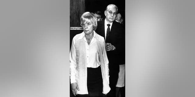 In this Feb. 1986 file photo, Marybeth Tinning is led from Schenectady County Court by Sheriff Bernard Waldron in Schenectady, N.Y.