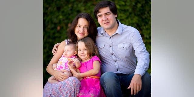 In this 2014 file photo, concert pianist Vadym Kholodenko, poses with his wife Sofya Tsygankova and daughters, Nika, center, and Michela, at their home in Fort Worth, Texas.