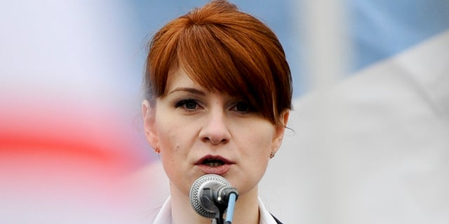 In this photo, Maria Butina, leader of a pro-gun organization in Russia, speaks to a crowd during a rally in support of legalizing the possession of handguns in Moscow.