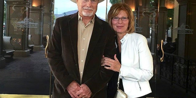 Bobby Wilson and his wife, Eileen Pein Wilson, stand outside Casino del Sol near Tucson, Ariz. Wilson, a Republican Arizona state Senate candidate, has shocked gun control advocates by sharing details about shooting and killing his mother in apparent self-defense more than 50 years ago.