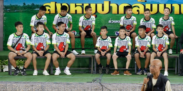 Members of the rescued soccer team and their coach sit during a press conference discussing their ordeal in the cave in Chiang Rai, northern Thailand.