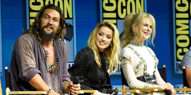 """Jason Momoa, from left, Amber Heard and Nicole Kidman speak at the Warner Bros. Theatrical panel for """"Aquaman"""" on day three of Comic-Con International on Saturday."""