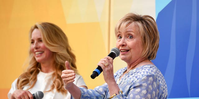 Democratic presidential candidate and former Secretary of State Hillary Rodham Clinton, right, speaks with Laurene Powell Jobs at OZY Fest in Central Park, New York City, July 21, 2018.