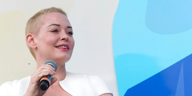 """Debuting a bleached buzz cut, McGowan told the New York City audience that the president is """"just too dumb"""" to keep his thoughts to himself."""