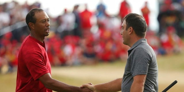 Francesco Molinari of Italy beats out Tiger Woods for the Open Championship.