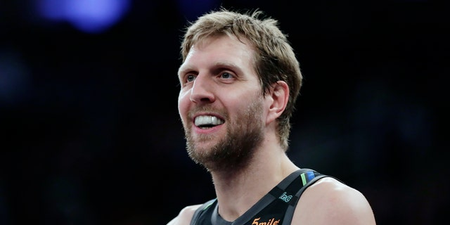 Dallas Mavericks' Dirk Nowitzki smiles during the second half of an NBA basketball game against the New York Knicks, in New York,  March 13, 2018.