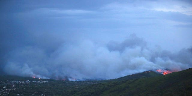 Smoke and fire coming from the town of Mati, east of Athens, Monday, July 23, 2018.