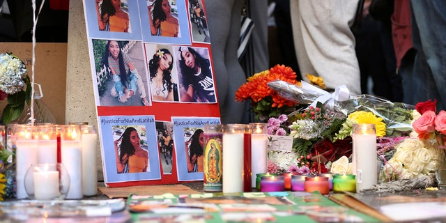 A memorial for 18-year-old Nia Wilson takes shape outside Bay Area Rapid Transit's MacArthur Station, Monday, July 23, 2018, a day after she was fatally stabbed on a platform at the station, in Oakland, Calif.